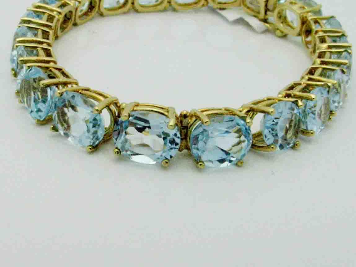 11848 14K YELLOW GOLD BLUE TOPAZ  BRACELET